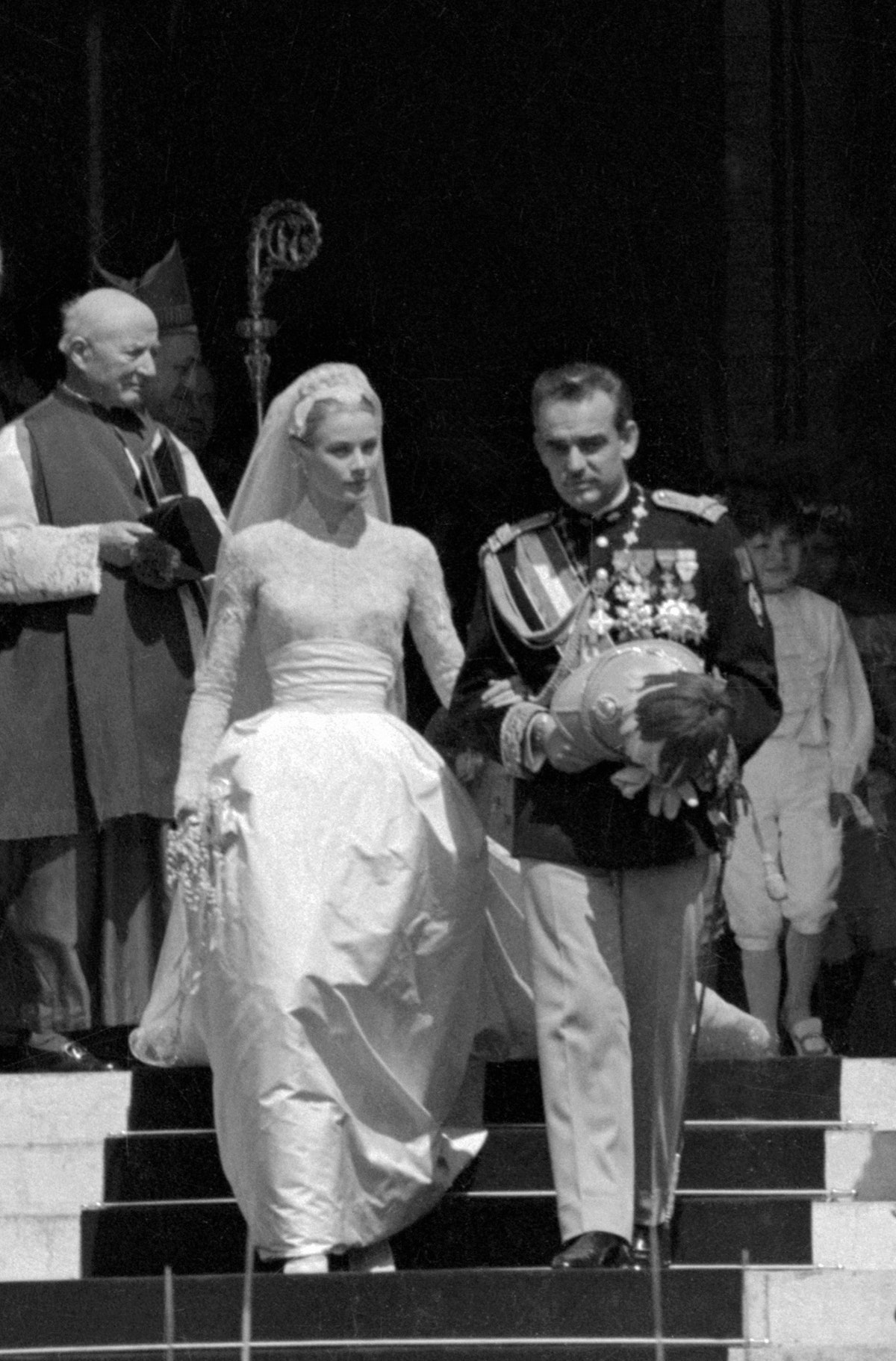 Grace Kelly wore a Cathedral wedding gown, created for her by American costume designer Helen Rose, ...