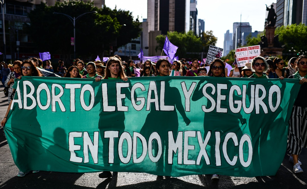 """Women carry a banner reading """"Legal and Safe Abortion Across Mexico"""" as they march during the commem..."""