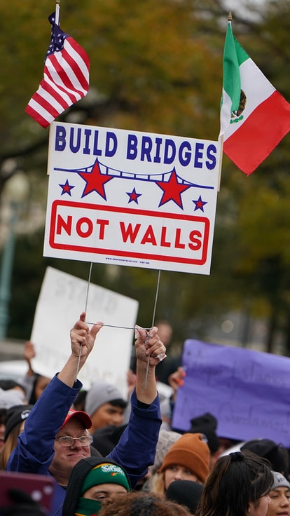 Immigration rights activists take part in a rally in front of the US Supreme Court in Washington, DC...