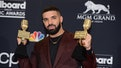 US rapper Drake poses in the press room during the 2019 Billboard Music Awards at the MGM Grand Gard...