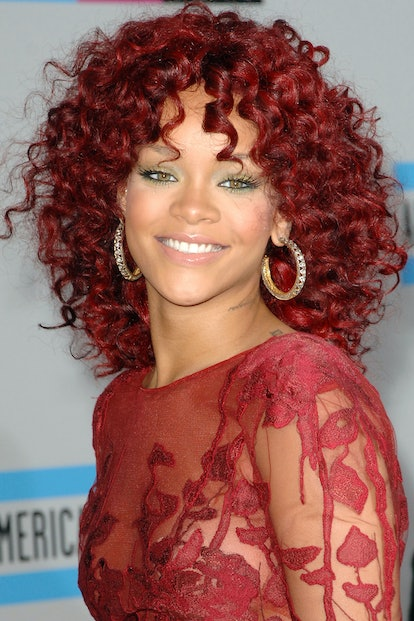 One fall 2021 hair color trend is brick red, the perfect marriage of brown, red, and gold hues (thin...