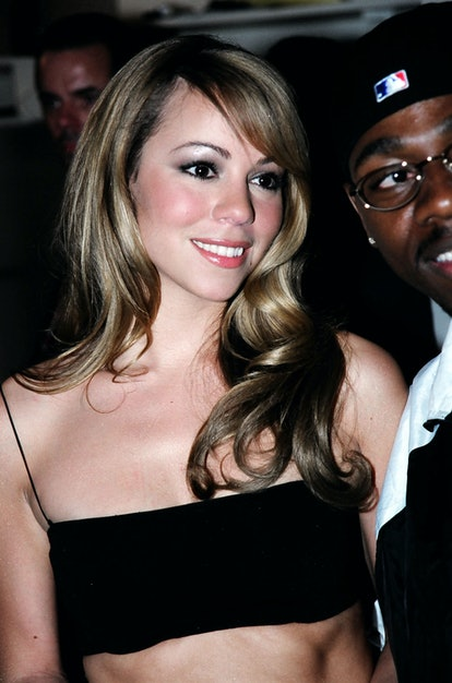 Mariah Carey's Old Hollywood hairstyle and black, two-piece outfit she wore to the VMAs in 1997 were...