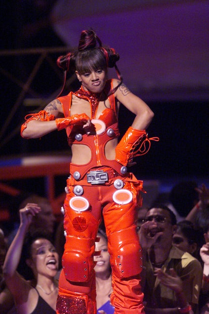 Lisa 'Left Eye' Lopes of TLC performing the 1999 MTV Music Video Awards with an iconic hairstyle.