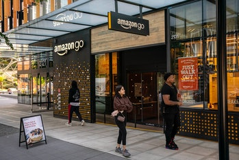SEATTLE, WA - MAY 20: People walk by an Amazon Go store at the Amazon.com Inc. headquarters on May 2...