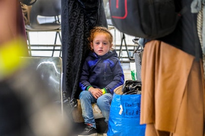 A child evacuee is pictured at the US Air Base Ramstein, Germany on August 26, 2021. - The Ramstein ...