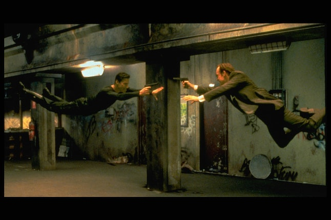 Keanu Reeves and Hugo Weaving face each other in a scene from Andy and Larry Wachowski's 1999 movie ...