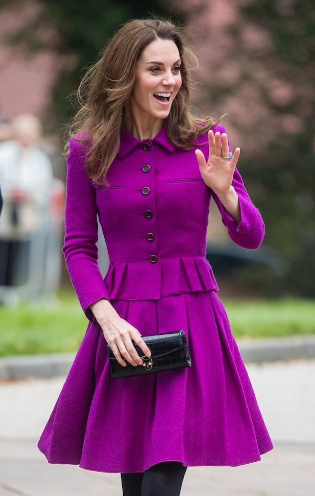 Kate Middleton wore a royal purple coat.