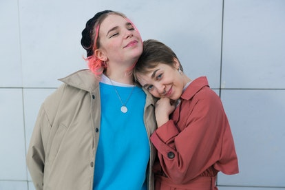 two friends embracing as they chat about october 15 being the best day for every zodiac sign