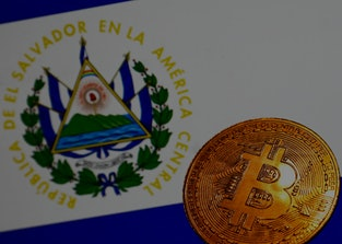 Representation of Bitcoin cryptocurrency and El Salvador flag displayed on a laptop screen are seen ...