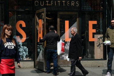NEW YORK, NY - APRIL 11: A customer walks into an Urban Outfitters store in the Herald Square neighborhood ...