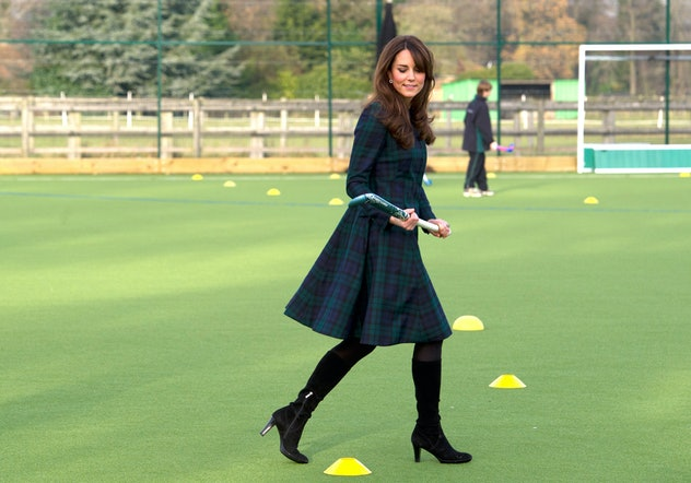 Kate Middleton removes a plaid.
