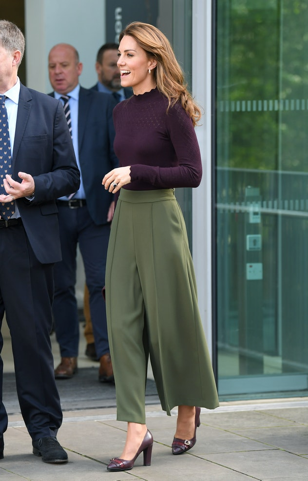 Kate Middleton tries on wide pants and a turtleneck.