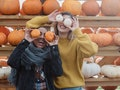 Pumpkin puns for Instagram are great for these two friends holding mini pumpkins over there eyes in ...