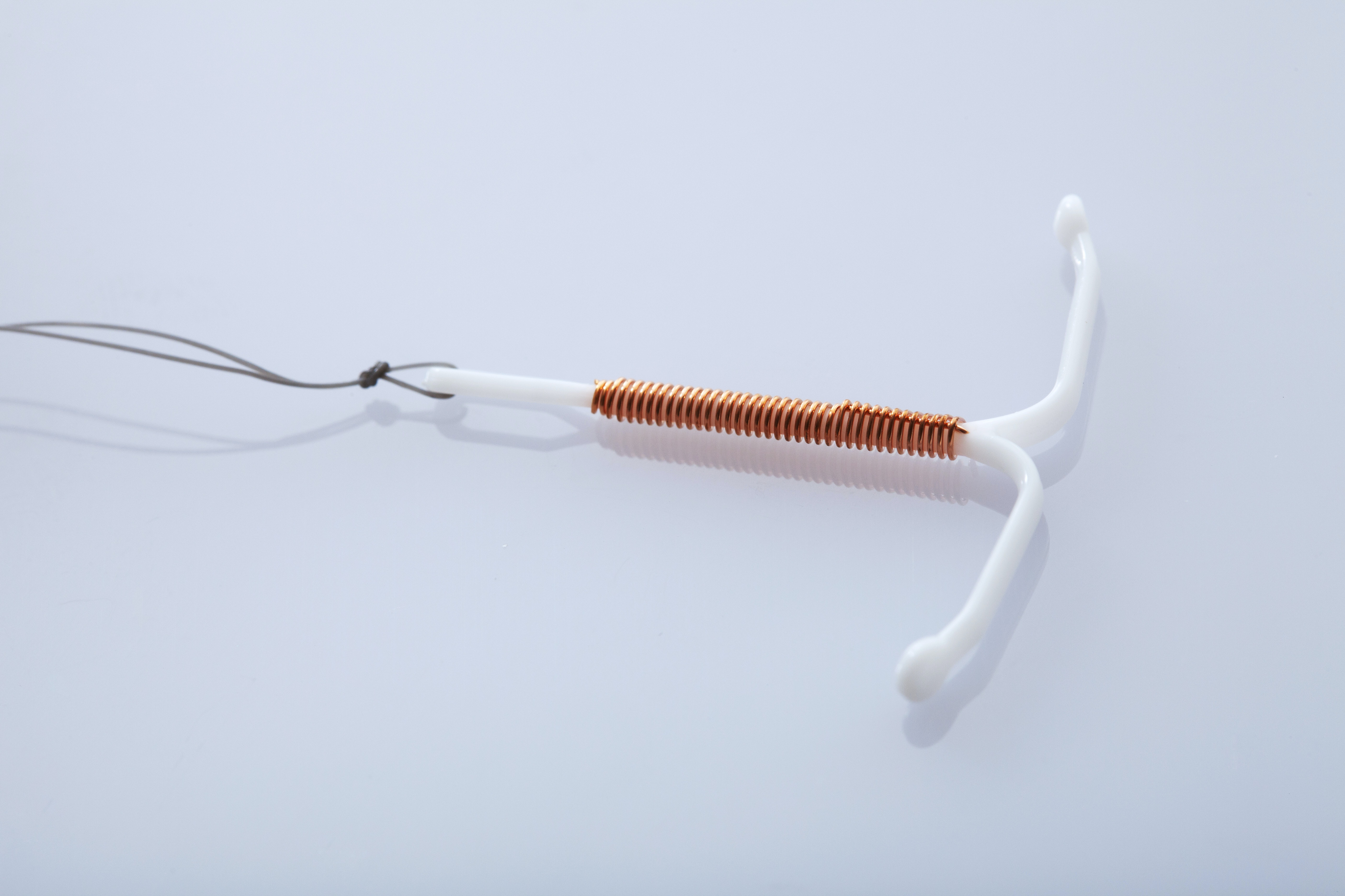 6 Signs You're Pregnant With An IUD, According To An Expert