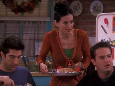 """still from a Thanksgiving episode of """"Friends"""" with Ross, Monica, and Chandler"""