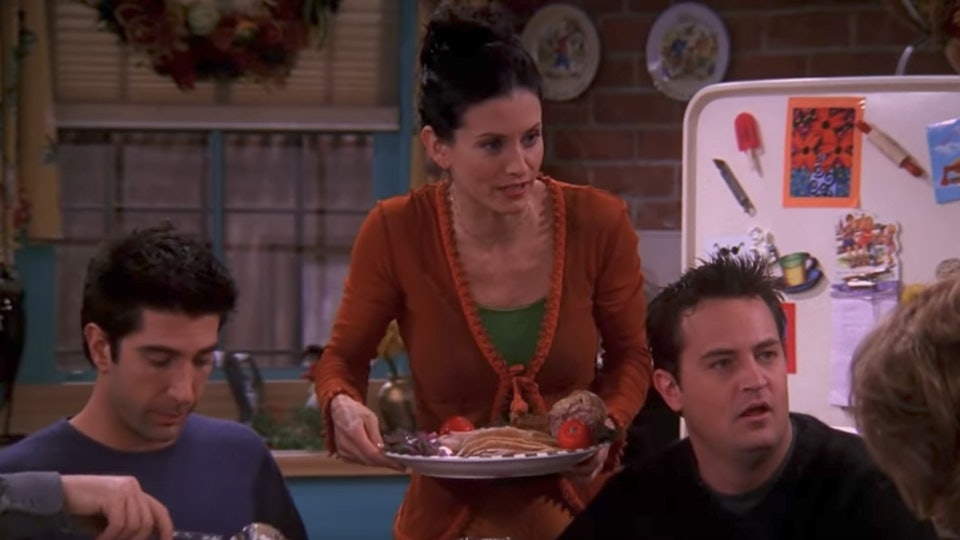"still from a Thanksgiving episode of ""Friends"" with Ross, Monica, and Chandler"