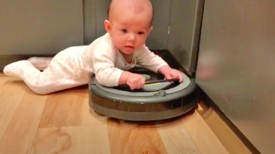 This Viral Video Of A Baby Riding A Roomba Is The Cutest & Most ...