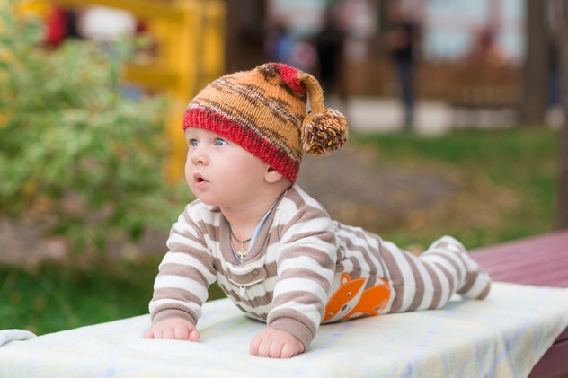baby outside with hat