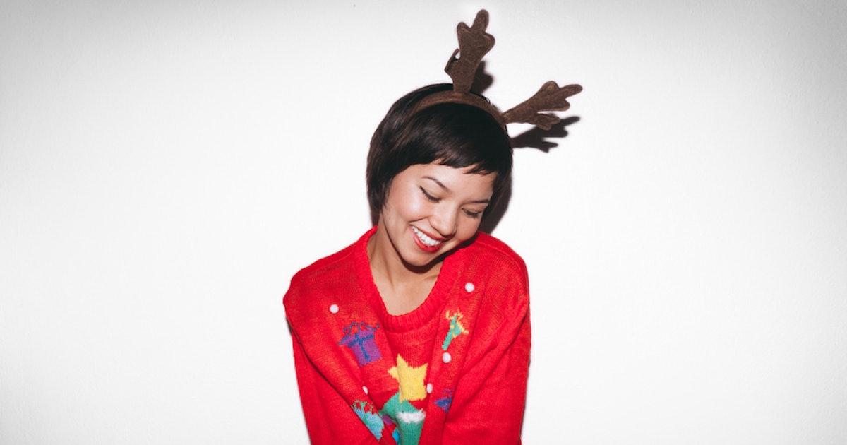 93605222 fbf6 493d b3c9 ec3d85cfc671 woman smiling red christmas sweater antlers headband jpg?w=1200&h=630&q=70&fit=crop&crop=faces&fm=jpg.'