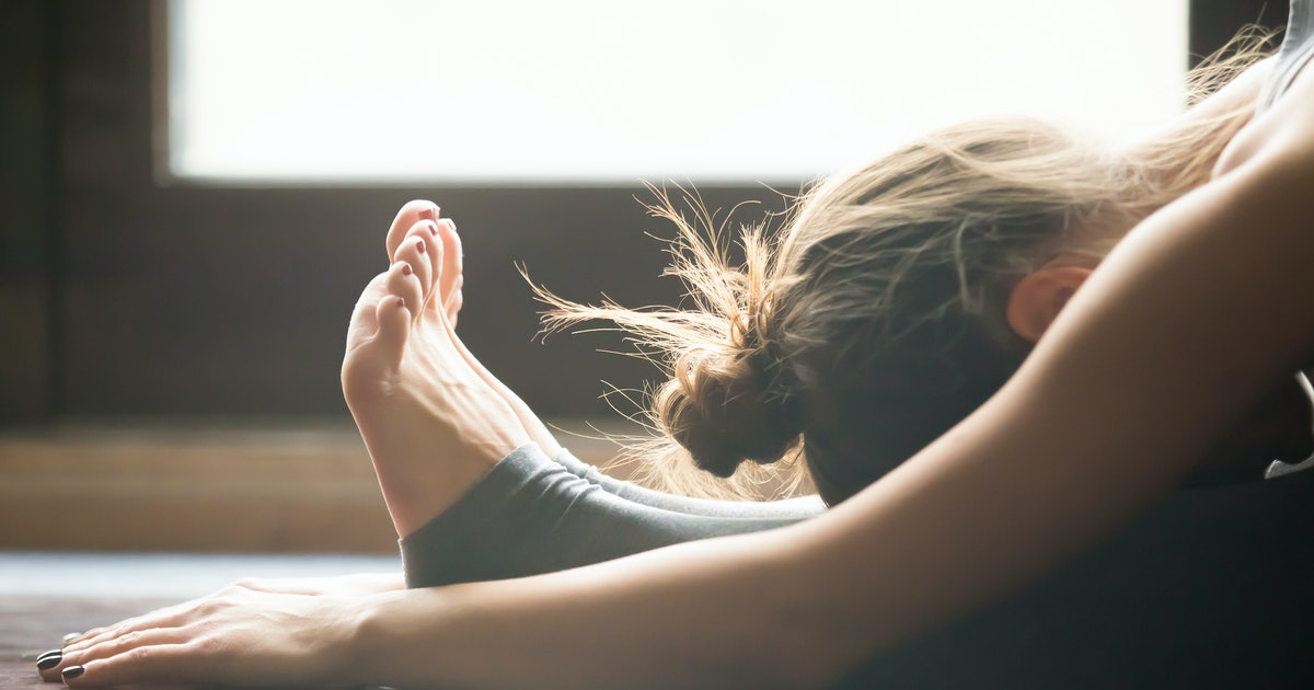 10 Yoga Poses For A Cold That'll Nurse Your Body Back To Health