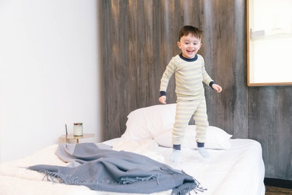 toddler going through a sleep regression, jumping on the bed