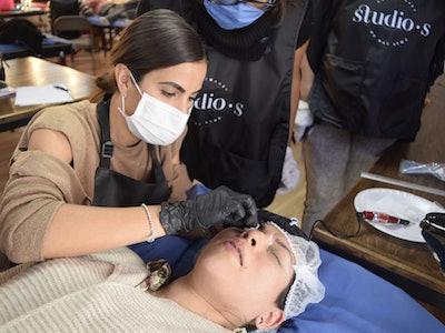 Customer getting microbladed eyebrows