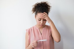 woman looking at pregnancy test