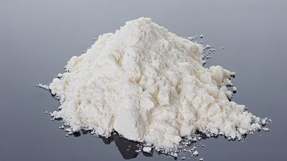 cocaine powder on a black surface