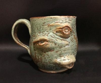 Three Eyes On A Mug