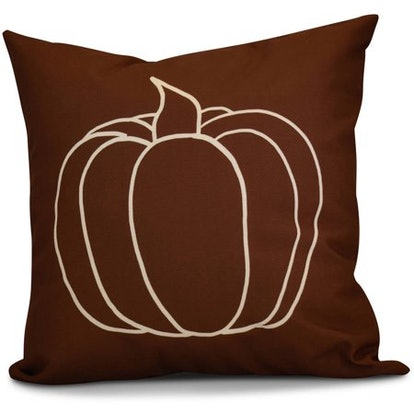 Sometimes, keeping it simple is best. Skip the quote pillow and opt for this sleek pumpkin outline option instead—it will look cool year after year, and it will blend in with plenty of different design styles.