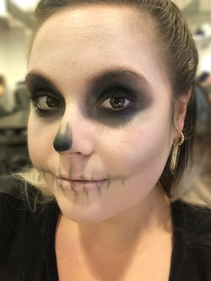 Elite Daily Senior Style Editor Theresa Massony models an easy skull makeup look for Halloween