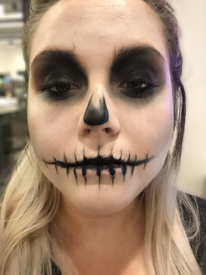 Using black eyeshadow and black eyeliner to create a skeleton makeup look for Halloween is key to a ...