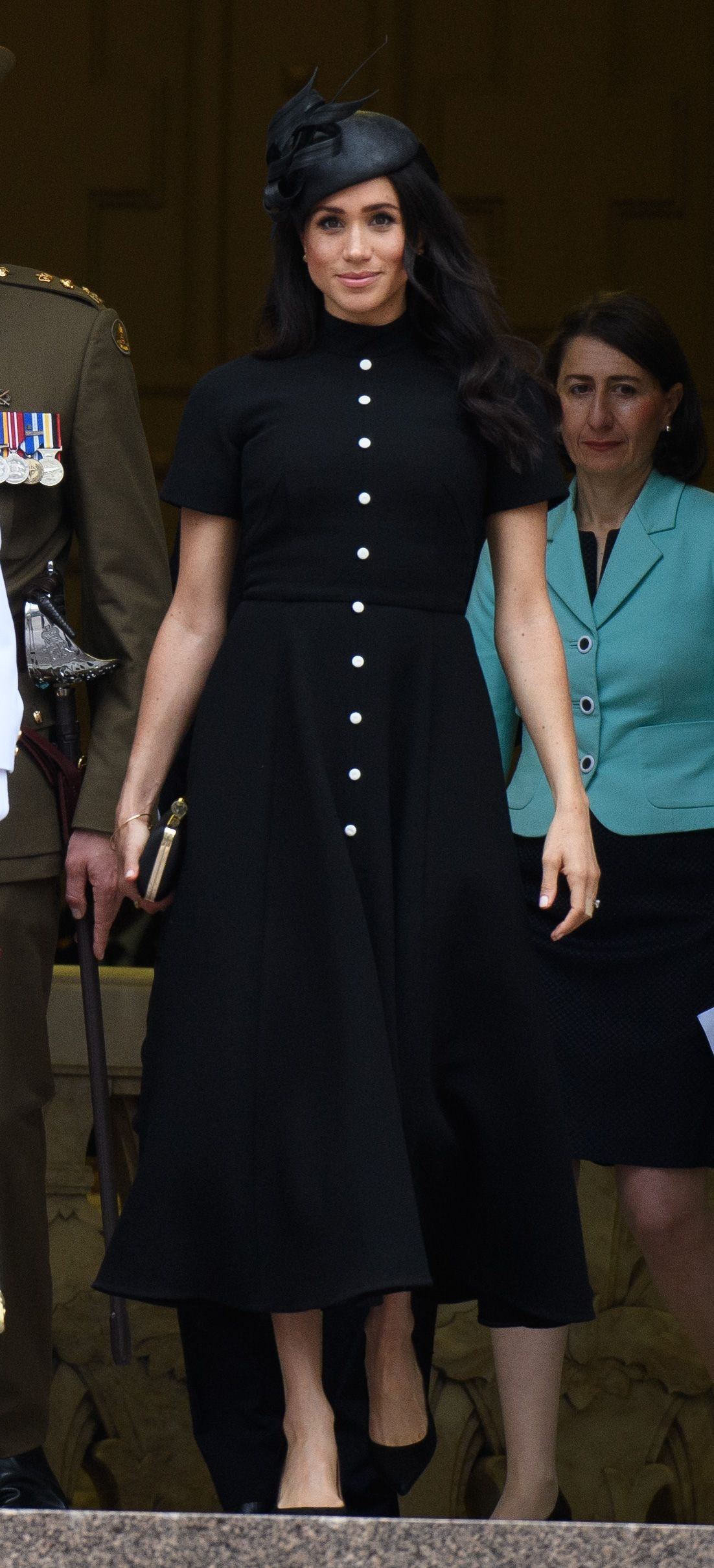 3c29b001bf6 Meghan Markle s Black Emilia Wickstead Dress Is The Same Style As One Worn  By Prince Harry s Reported Ex