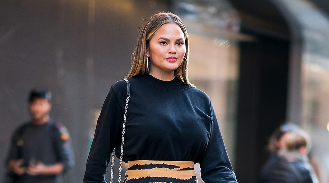 3b020c2b36a7f Chrissy Teigen's Black Cardigan Dress Is So Versatile (& It's Under $200)