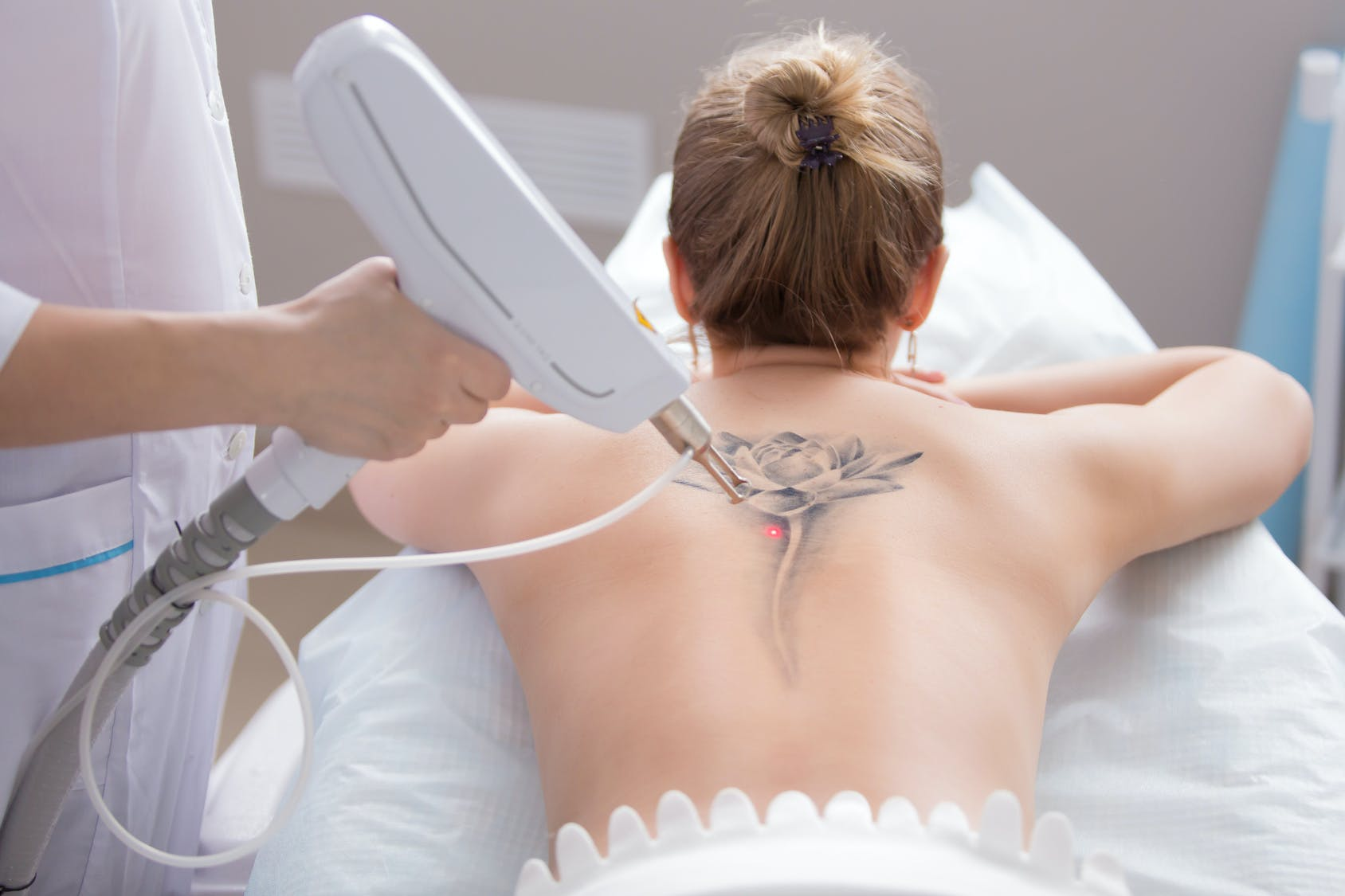 The 7 Most Common Tattoos Women Get Removed According To Laser Surgeons