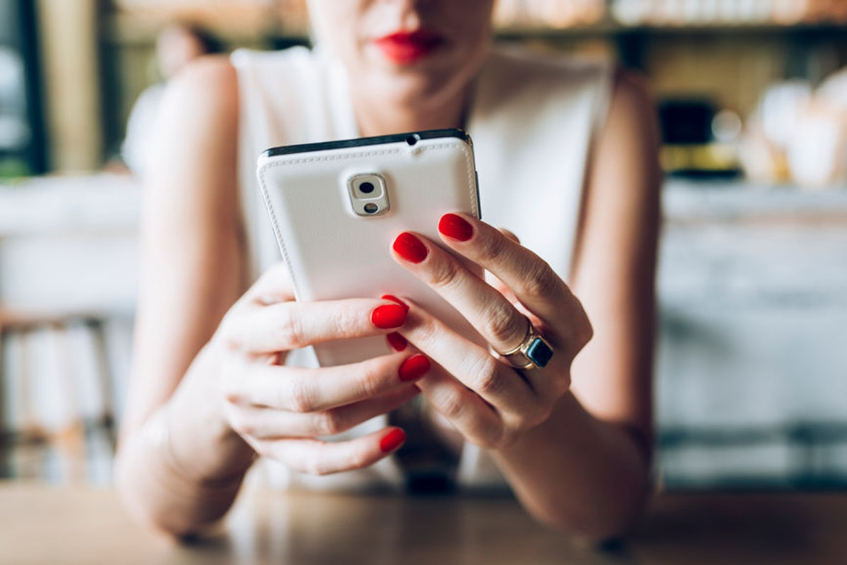 Woman texting back her partner who cancelled plans.