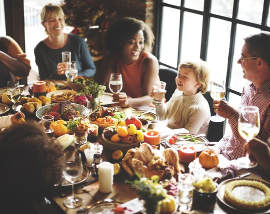 a family seated around a thanksgiving table