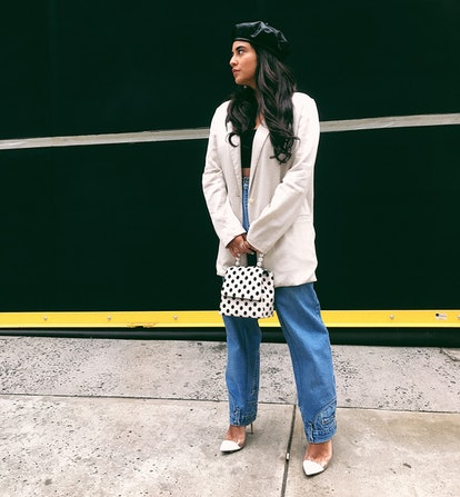 Chillhouse founder and blogger Cyndi Ramirez wears her baggy, anti-skinny jeans with an oversize blazer, some heels and a structured handbag.