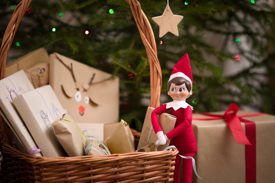 an Elf on the Shelf doll with a basket of packages