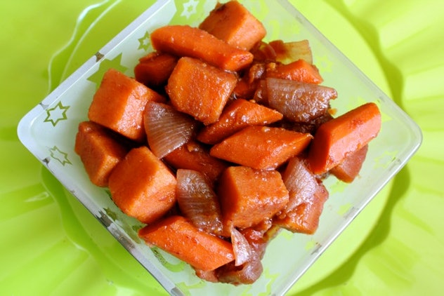 cooked carrots and onions in a bowl