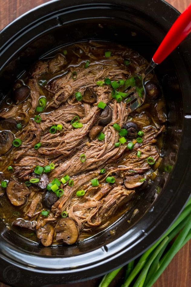 slow cooker full of beef brisket shredded
