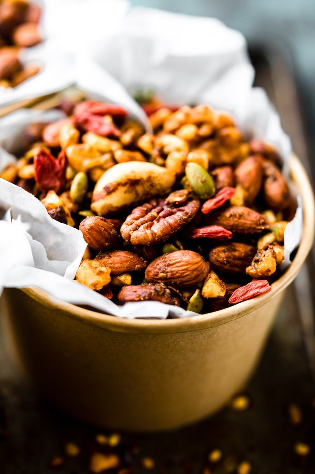 close up of bowl full of walnuts, almonds and other nuts