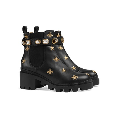 Embroidered leather ankle boot with belt