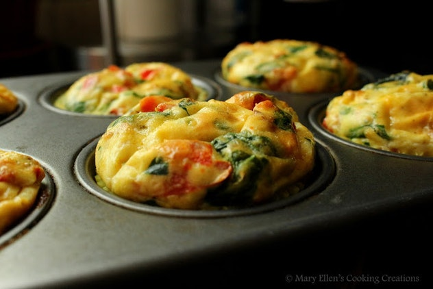 muffin pan with omelette mixture cooked into egg muffin