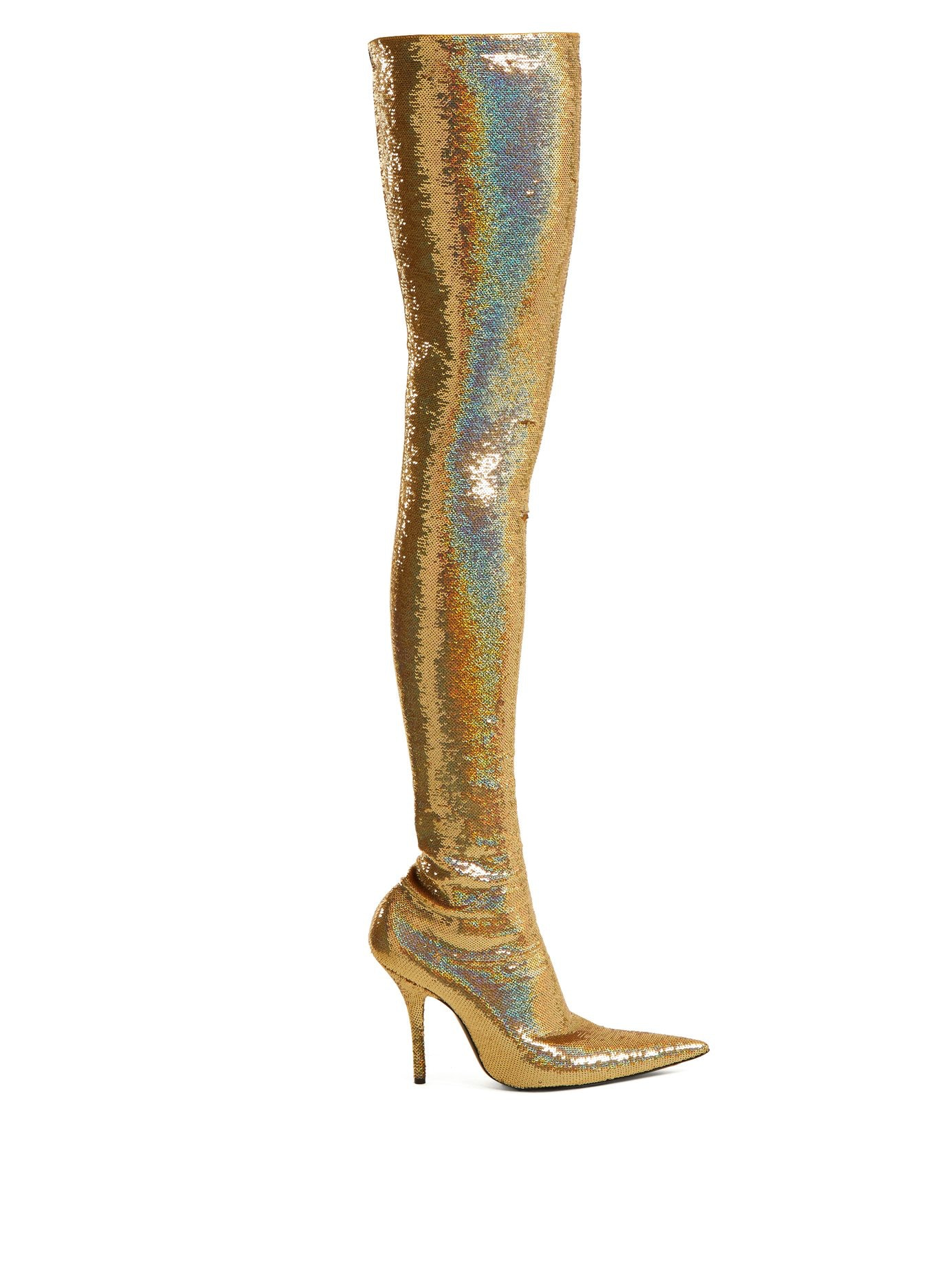 3963e8f52c6 Michelle Obama s Thigh-High Gold Boots Are A Bold Addition To Her Closet