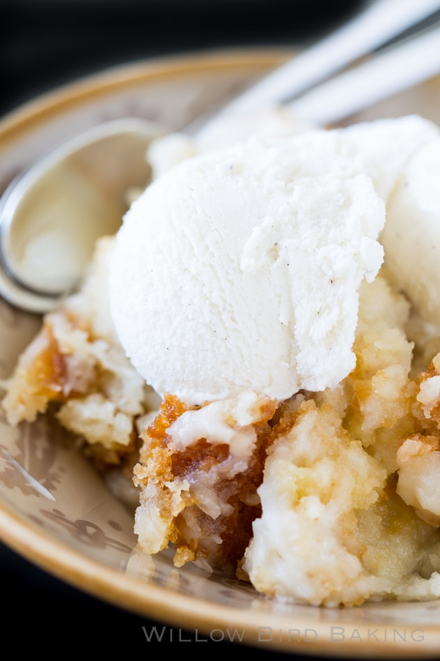slow cooker full of coconut cake with ice cream on top