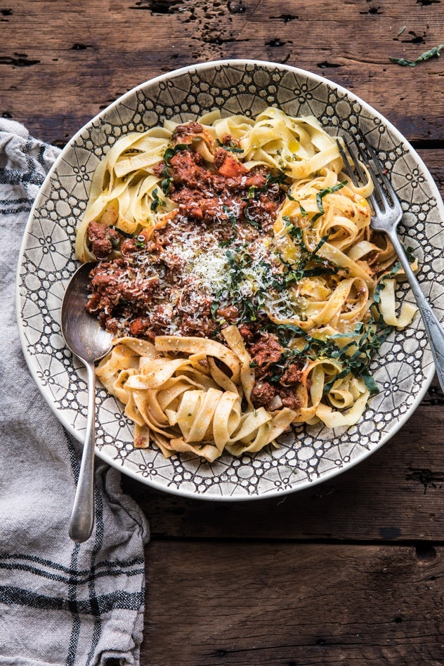 pasta with a meat sauce on top on a plate