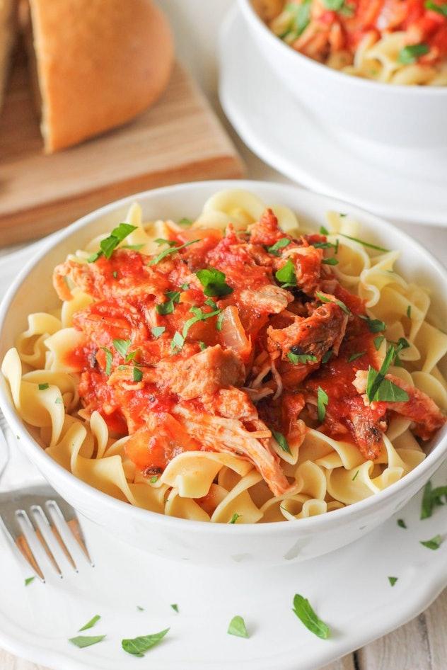bowl of pasta with ragu sauce on top
