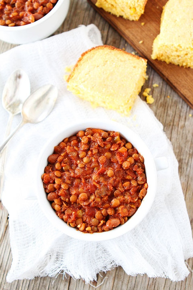 bowl of lentil chili with side of corn bread