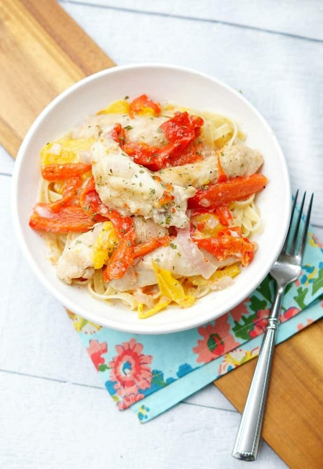 pasta covered with chicken scampi and cooked bell peppers